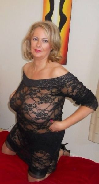 Mature big tits in tight clothes