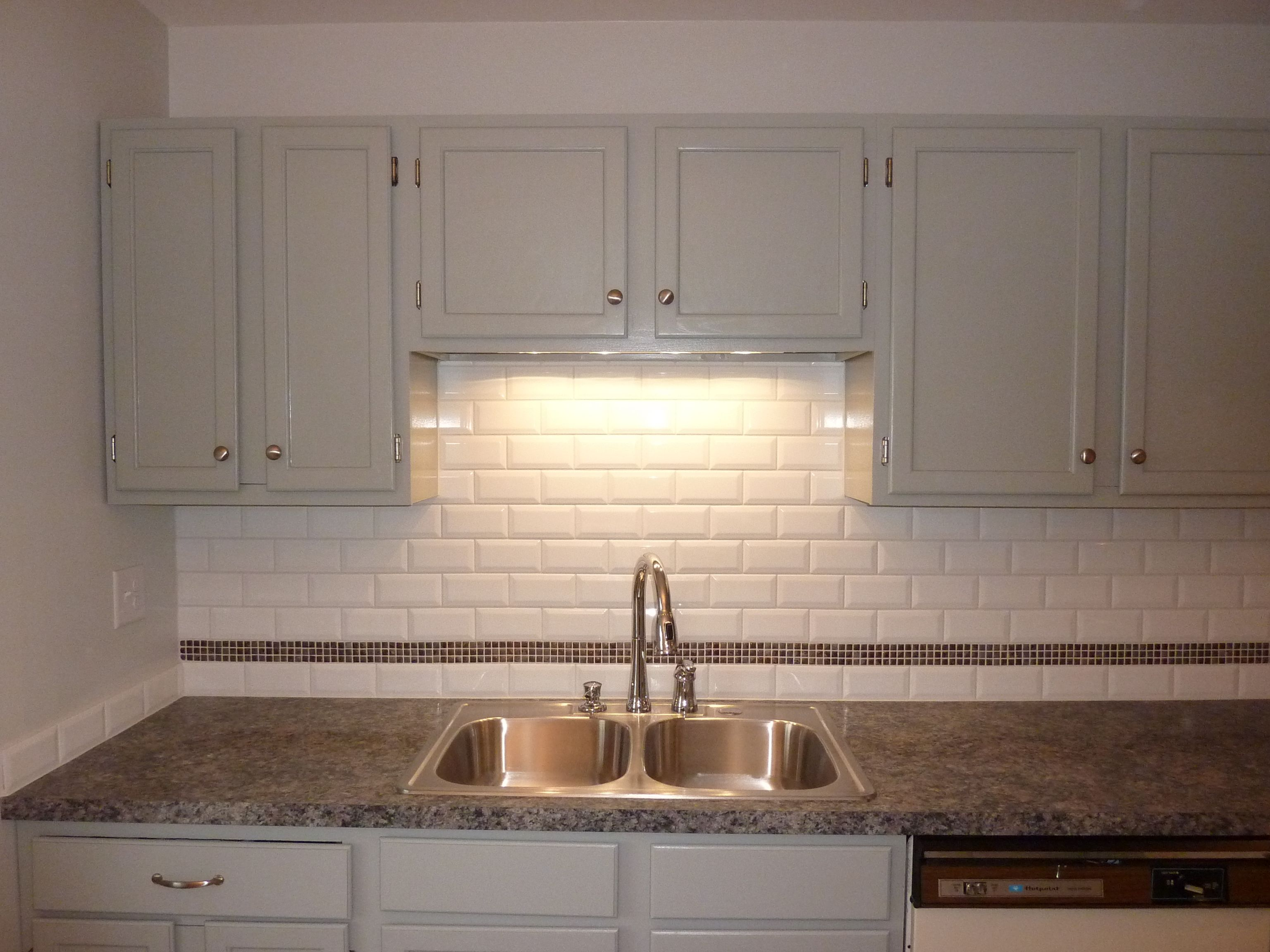 Painted gray cabinets 3d white subway tiles with a stonemosaic painted gray cabinets 3d white subway tiles with a stonemosaic strip laminate dailygadgetfo Choice Image