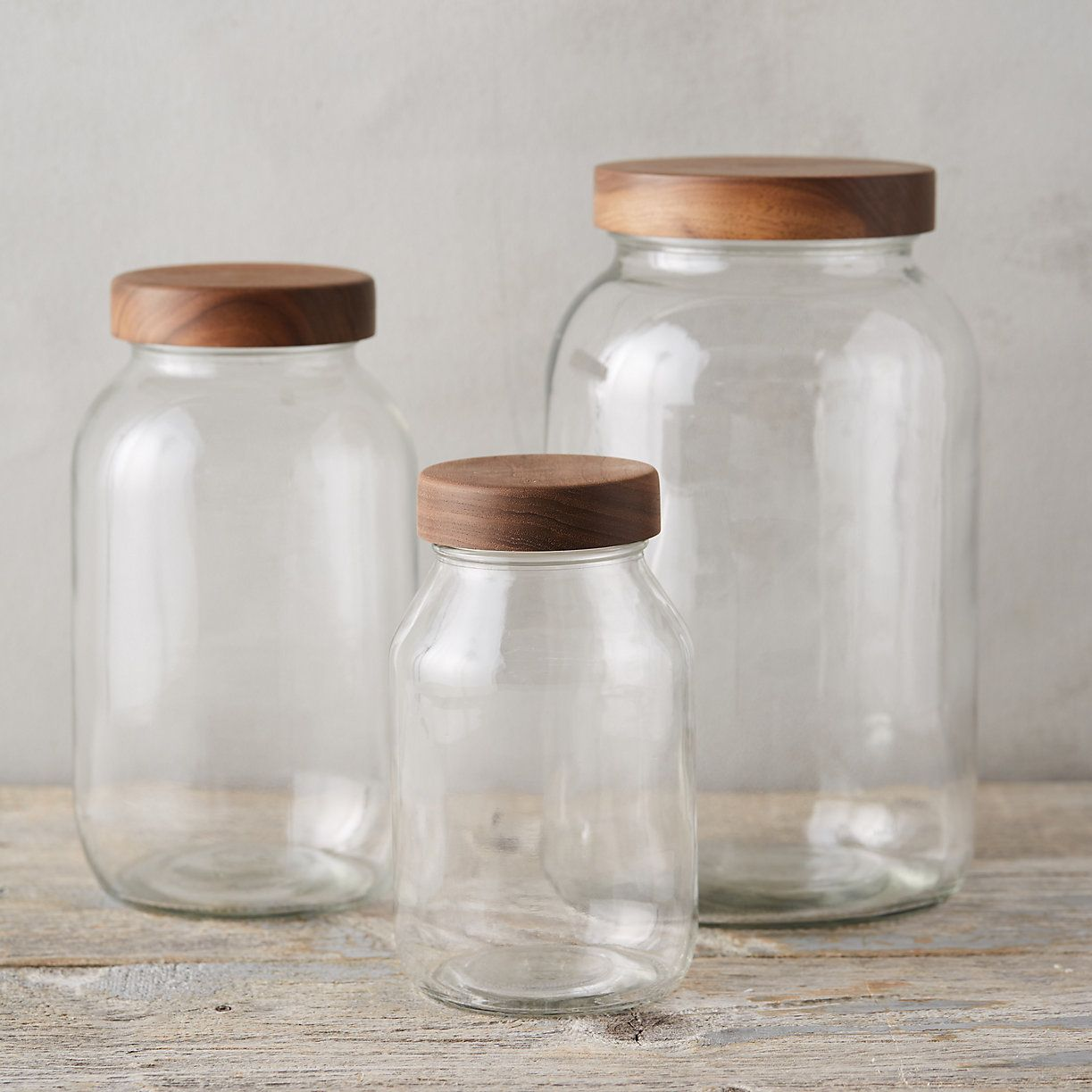 A pretty and practical option for pantry storage, this glass jar features a hand-turned walnut lid. Concealed by the walnut exterior, a metal cap and