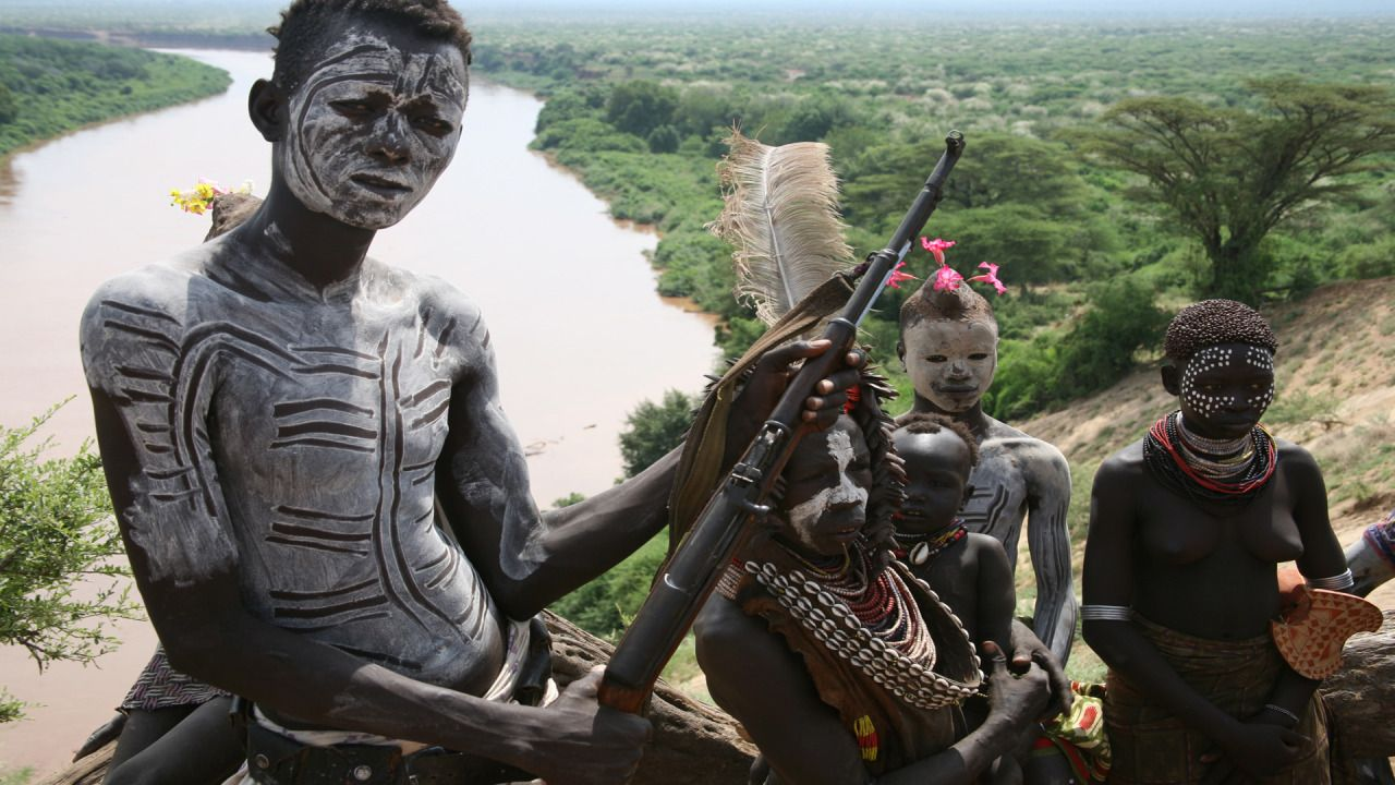 A child fighter in the Omo River Valley with his Chinese-made Type 56 carbine.