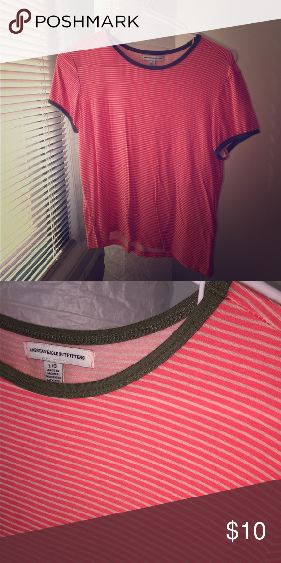 Pink and White Striped Tee Pink and White Striped Tee from American Eagle - size L. Feel free to ask any questions! :) Can model if requested! American Eagle Outfitters Tops Tees - Short Sleeve