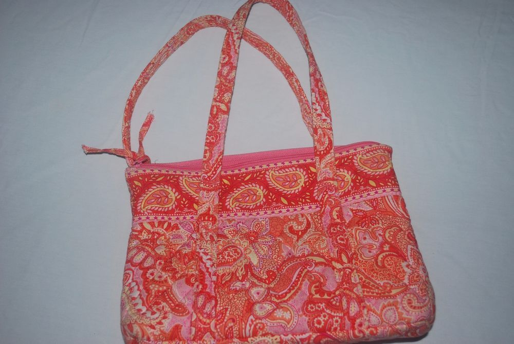 Orange and pink sherbet pattern. This is a Vera Bradley purse handbag with  double handles. Short handles.  66599c24e4c15