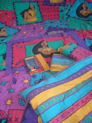 OMG This was my bedding set all through 5th grade and middle school I loved Pocahontas!!! She was my favorite princess.