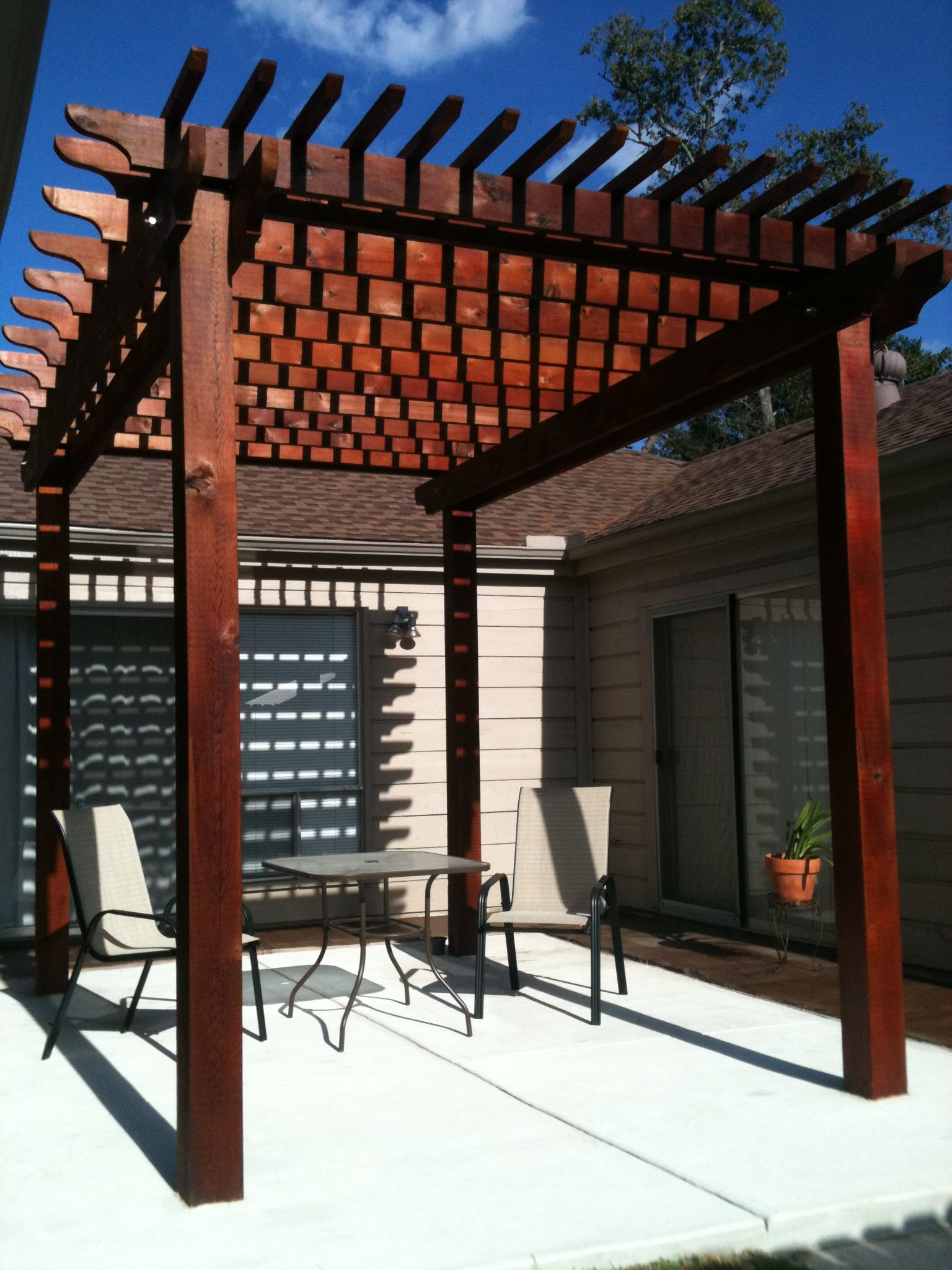 Rustic Outdoor Pergola And Stained Concrete Patio By The Western Patio Company In Spring Texas Pergola Patio Pergola Outdoor Pergola