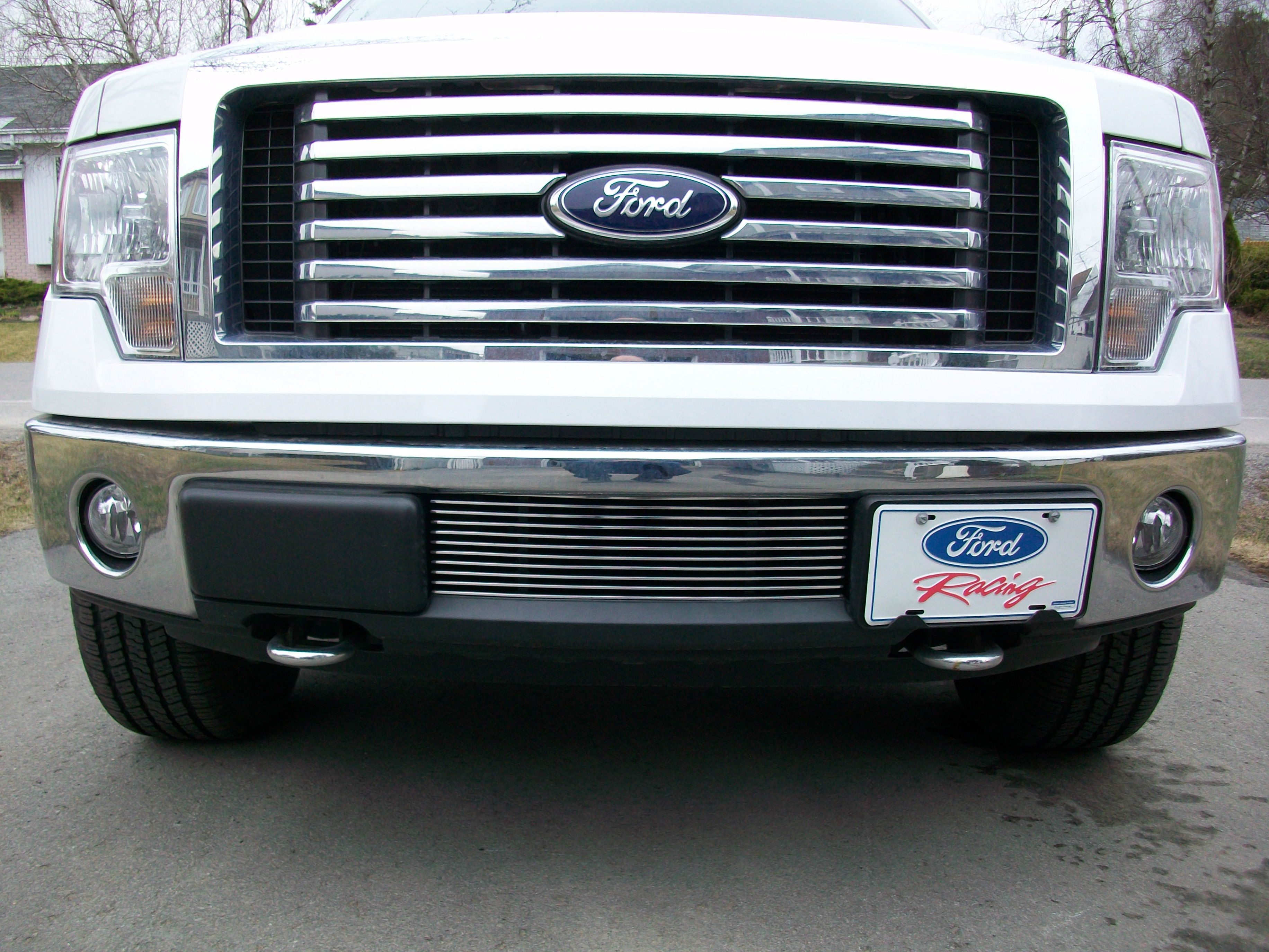 Ford f 150 with genx trims polished lower billet grille installed