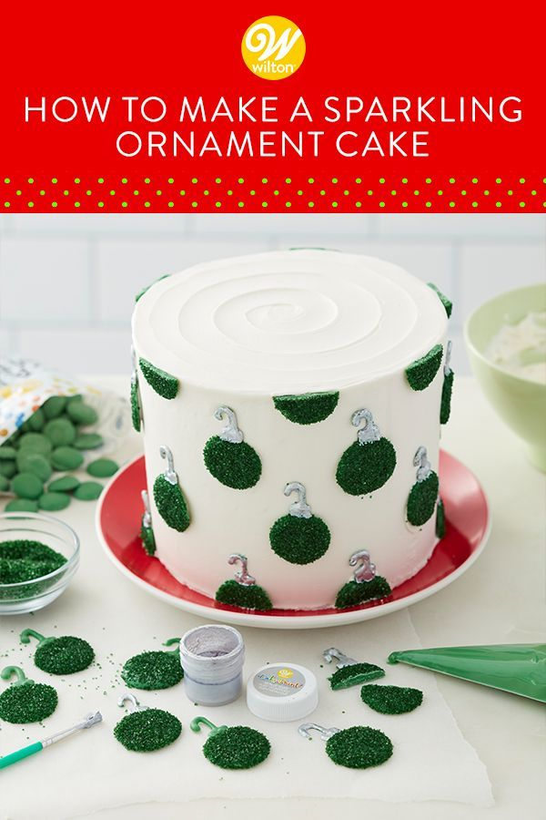 Forget piping decorations, this Sparkling Ornament Cake uses candy ornaments to add a cute holiday touch! Simply ice your cake, then use Dark Green Candy Melts candy and green sanding sugar to make candy ornaments. Arrange them around your cake and you're good to go! Use our wide assortment of candy and sanding sugars to make ornaments in all kinds of holiday colors. #wiltoncakes #christmascake #baking #homemade #cakedecorating #cakeideas #baking #candymelts #sprinkles #christmasparty #howto
