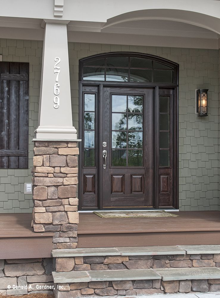 This front door has large windows that flood the foyer for House plans with large front windows
