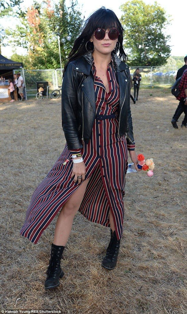 Style queen: The model teased a hint of cleavage and showed plenty of leg in a buttoned, blue and red striped dress