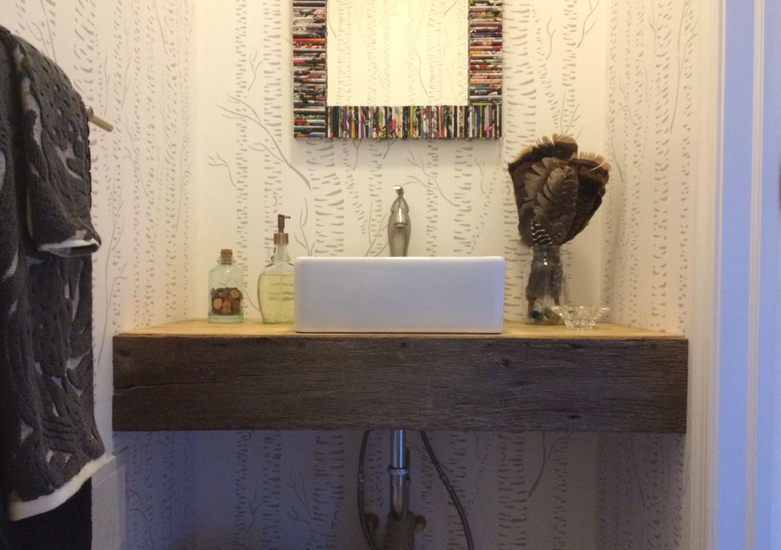 Powder room vessel sink with barn wood front