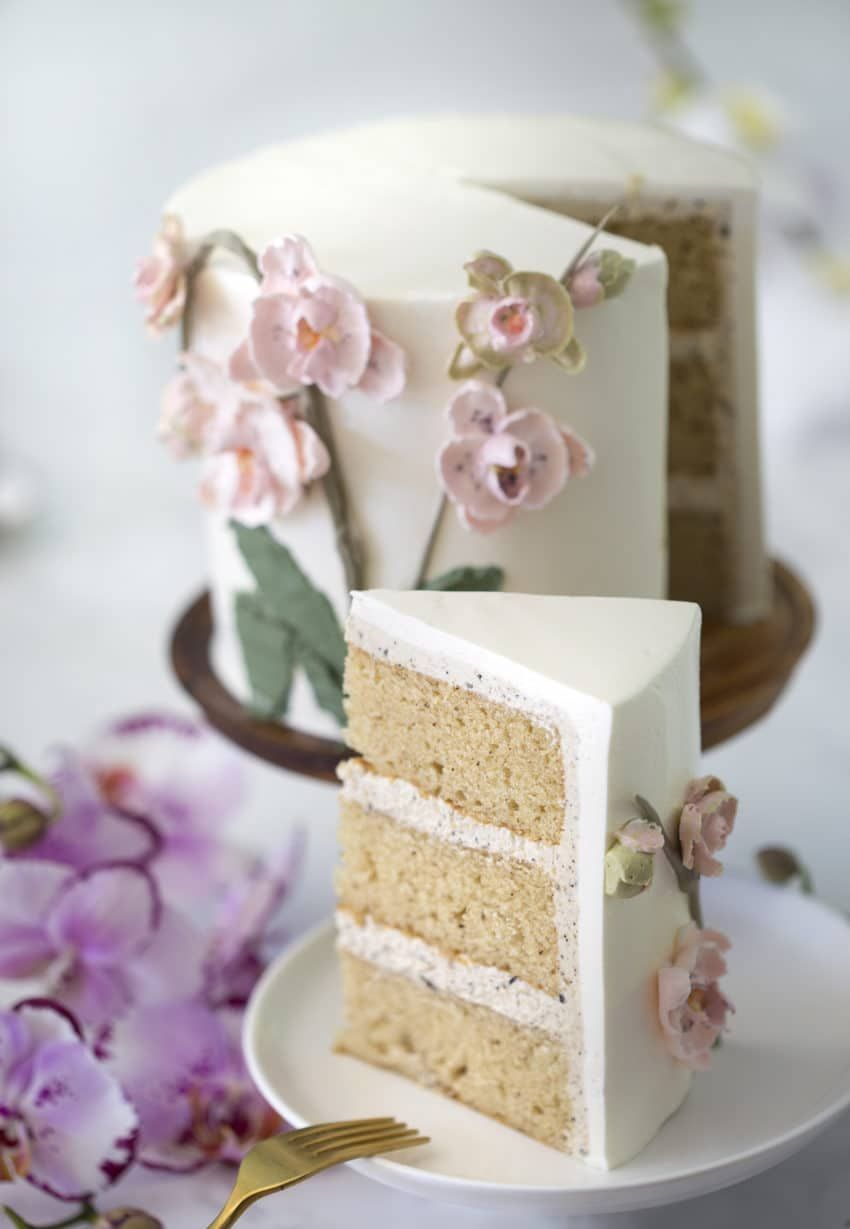 Photo Of A Brown Butter Cake Covered In Buttercream Orchids With A