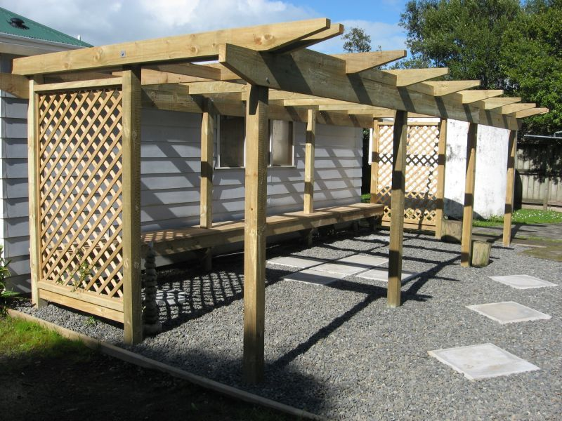 Constructed with standard rough sawn treated timber. Trellis added for semi privacy and a frame for climbing plants. Benches add ample seating and room to lie down.