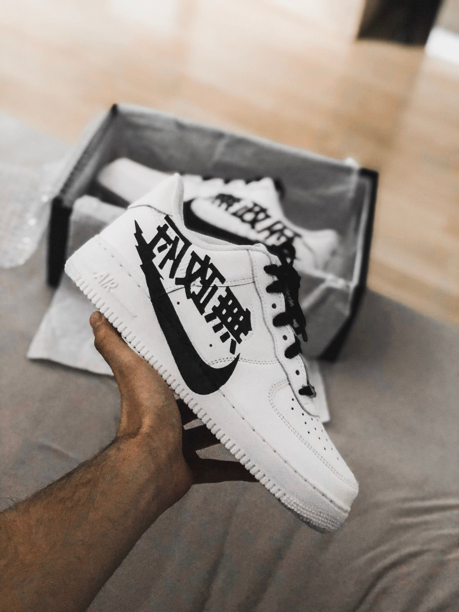 7f3db379 This timeless Nike Air Force 1 low-top sneaker features a hand-painted  Japanese swoosh on the outside - partially covering the sole.