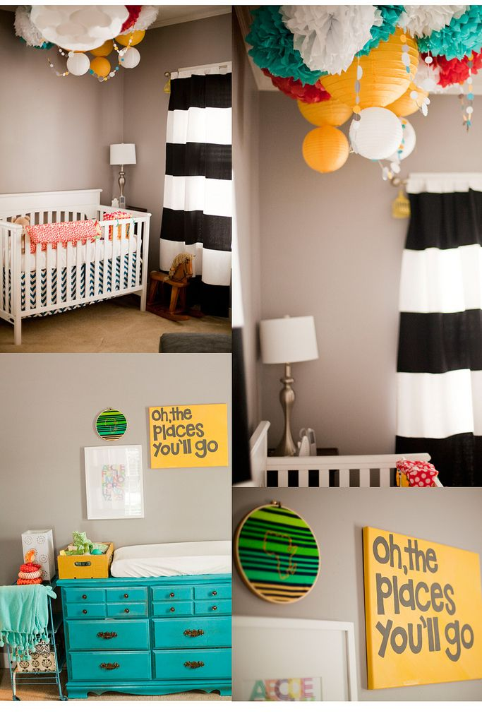 Another nursery with things I love, and some I don't... I like the grey walls... I like the blue and green accents - and I could do orange with it for a boy or purple with it for a girl... The pom pom/lantern grouping is cute... I don't like the pink/coral/red addition... I don't like the curtains...