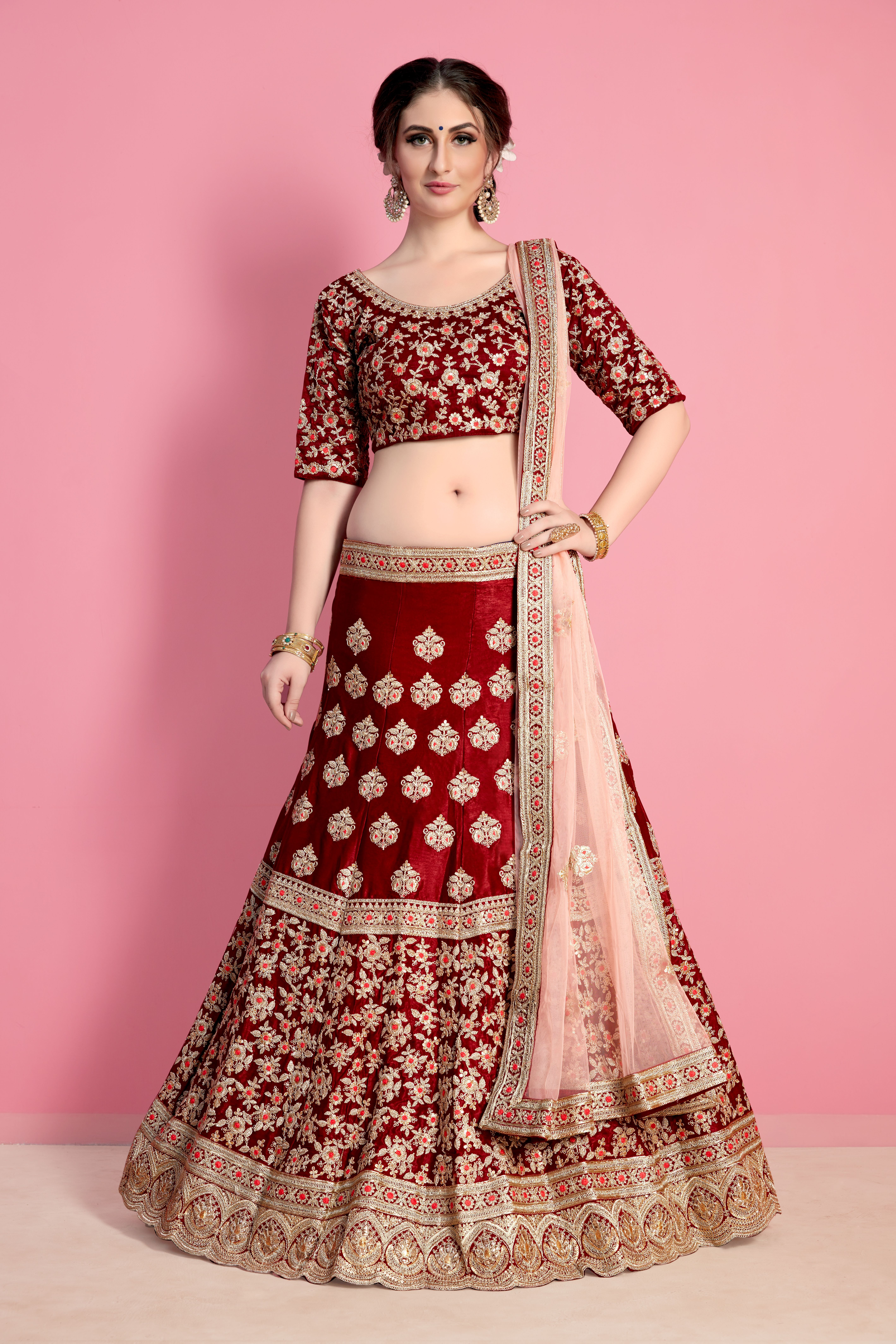 aa8334b7b9 Maroon velvet silk heavy embroidered bridal lehenga set. This lehenga set  is adorned with resham, sequins and dori work. Comes with a matching  unstitched ...