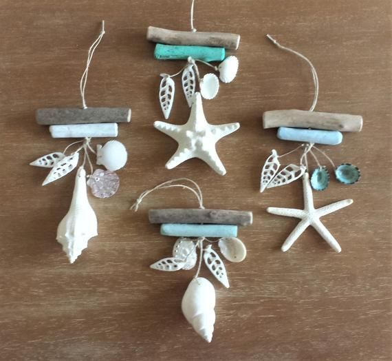 Beach Ornament, Coastal Decor. These beautiful coastal ornaments have been made with driftwood and real shells/starfish. You will be purchasing ONE ornament per order. There are two pieces of driftwood in each ornament, one painted and one unpainted. The painted piece of driftwood is available in a