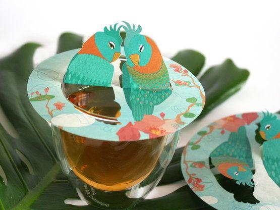 Spread Love The steam of your tea breathes the paper artwork alive..the parrots meet.. Steam Waverz; Design: Angeliek Caelen