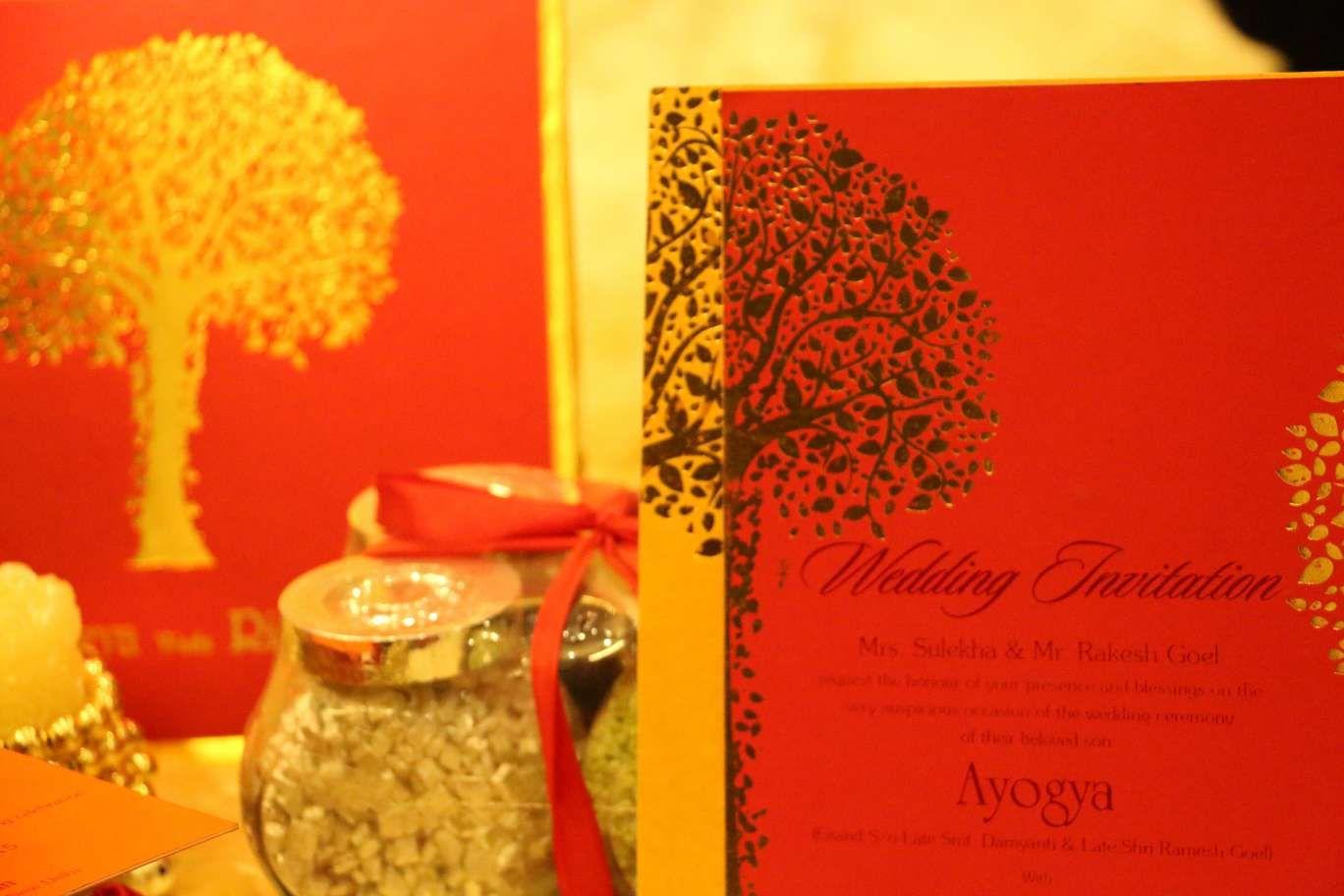 golden-tree-red-yellow-wedding-cards #newdelhi #weddinginvitation ...