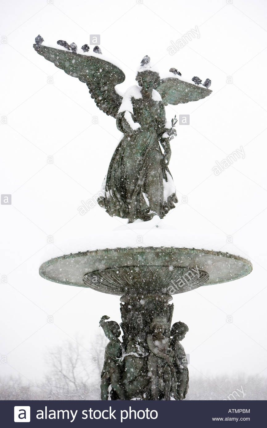 A bronze angel in the snow, Bethesda Fountain, Central Park