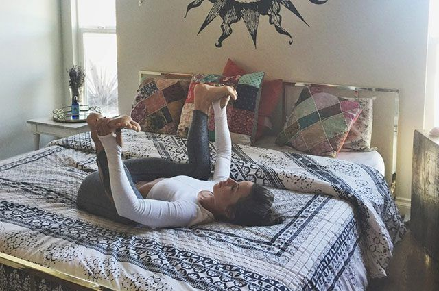 8 Energizing Yoga Moves You Can Do In Bed Bed Yoga Yoga Moves Happy Baby Pose