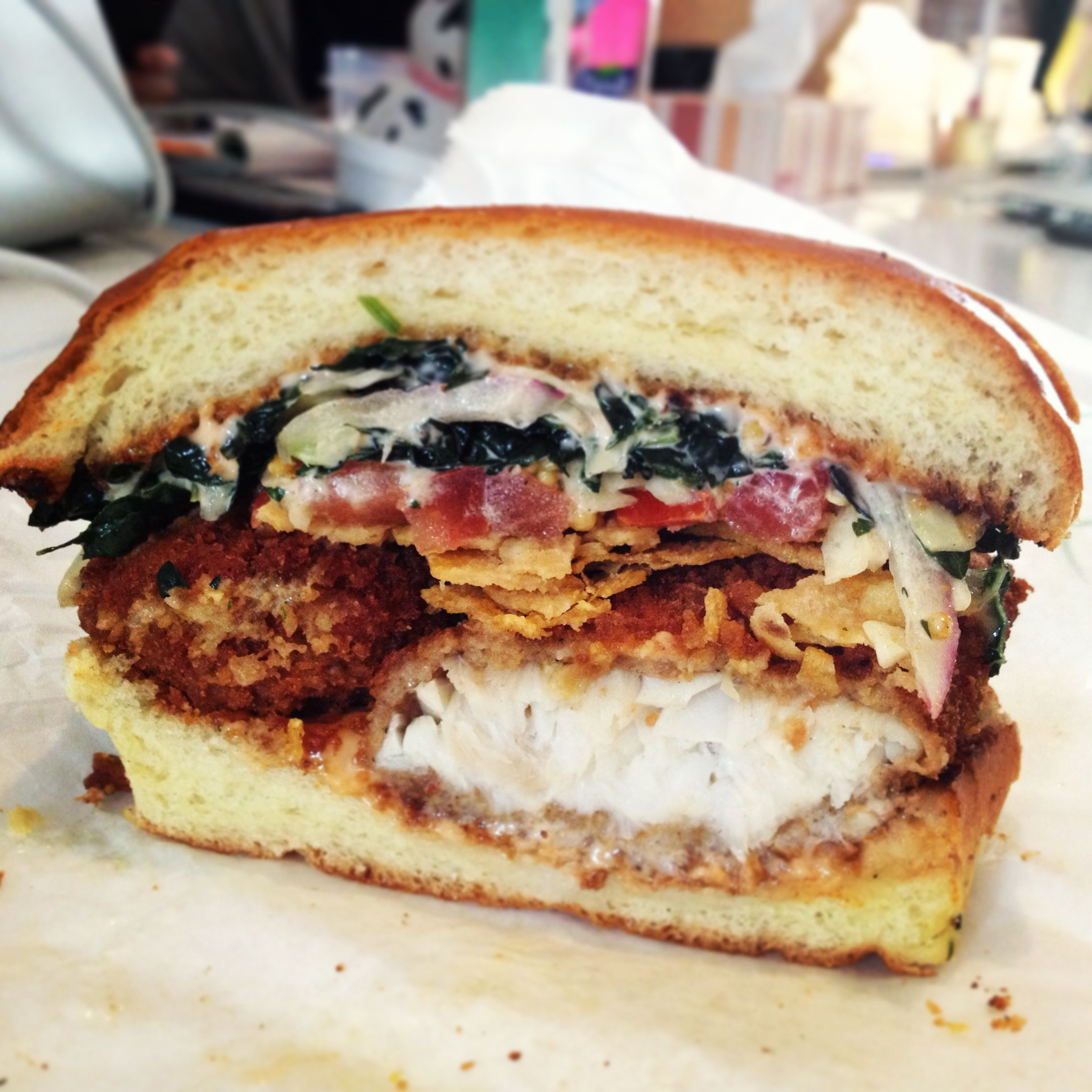 Fish Torta: Panko crusted tilapia with kale, chips, tomatoes, onion, and special sauce. #crack @Spread's spreads #nyc