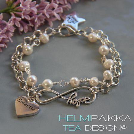 Infinity hope helmirannekoru sydänamuletilla | Helmipaikka Oy - Joka päivä on korupäivä - Helmipaikka.fi koruja netistä