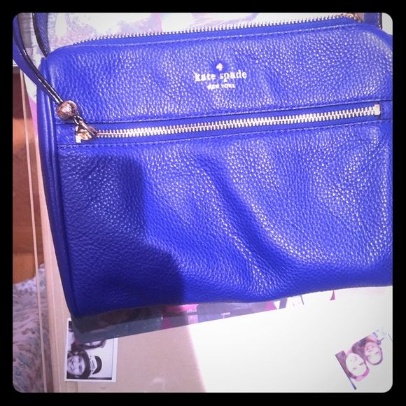 Kate Spade SUPER SALE Cayli Cross Bag lapiz blue DESCRIPTION A casual Kate Spade New York cross-body bag styled in pebbled leather. A zip pocket and logo stud outfit the front. Zip top and lined, 3-pocket interior. Adjustable shoulder strap. Color is bright lapis blue. COMES WITH CARE CARD.  Leather: Cowhide. Weight: 18oz / 0.51kg.   Measurements Height: 7in / 18cm Length: 9.5in / 24cm Depth: 2.25in / 5.5cm Strap drop: 23.25in / 59cm kate spade Bags Crossbody Bags