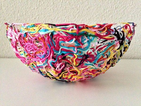 Colorful Yarn Bowl. Never throw away leftover bits and pieces from yarn projects because you can make a piece of art for your home decor. Tutorial via  <<<