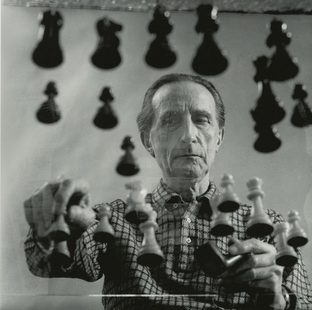 Marcel Duchamp playing chess at his 14th Street Studio in