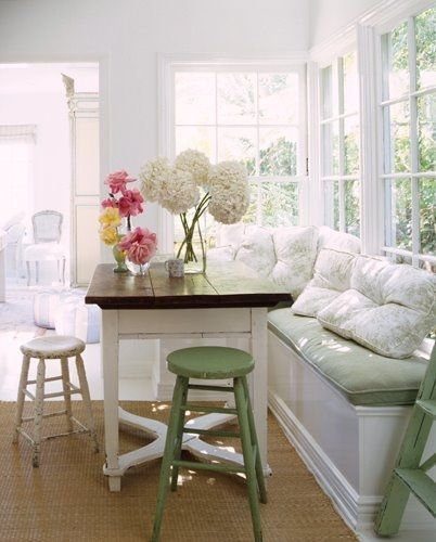 Bright kitchen, breakfast nook.  Bench window seating - via Today's Country Kitchen Decorating