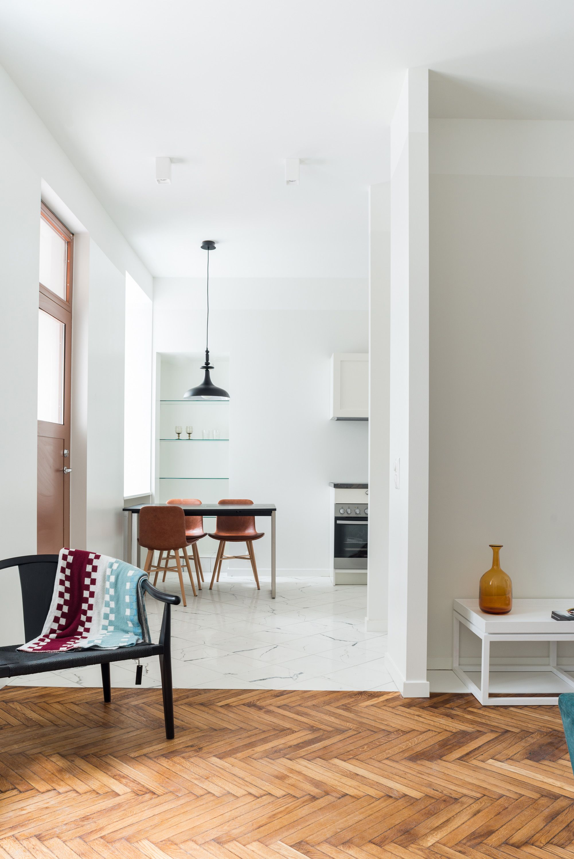 This designer apartment by Larsen Kinnisvara featuring high ceilings ...