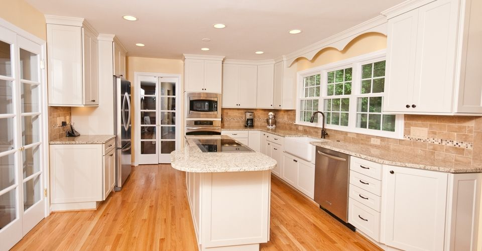 Large open kitchen with downdraft cooktop in island. Custom valance ...