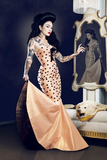 Vintage, rockabilly-style woman, in polkadot gown. Lovely peach ...