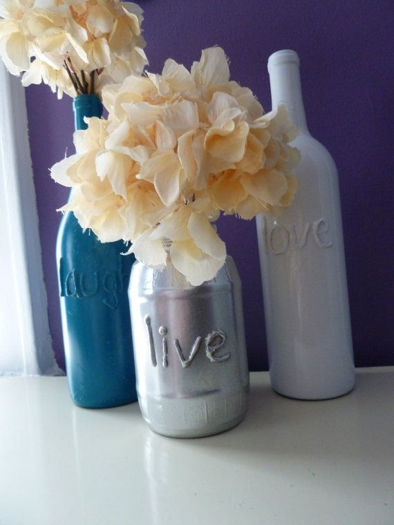 Upcycled glass bottles: Pour paint into the bottles (to preserve the glass sheen on the inside; on outside, paint looks flat and will chip). OR use Elmer's glue to paint letters/shapes, and paint over on outside.
