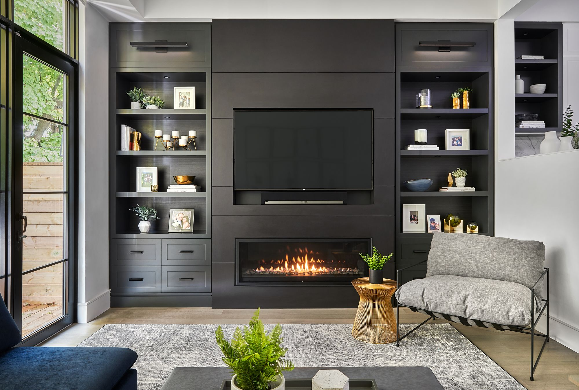 Custom living room wall unit with recessed TV and linear ...