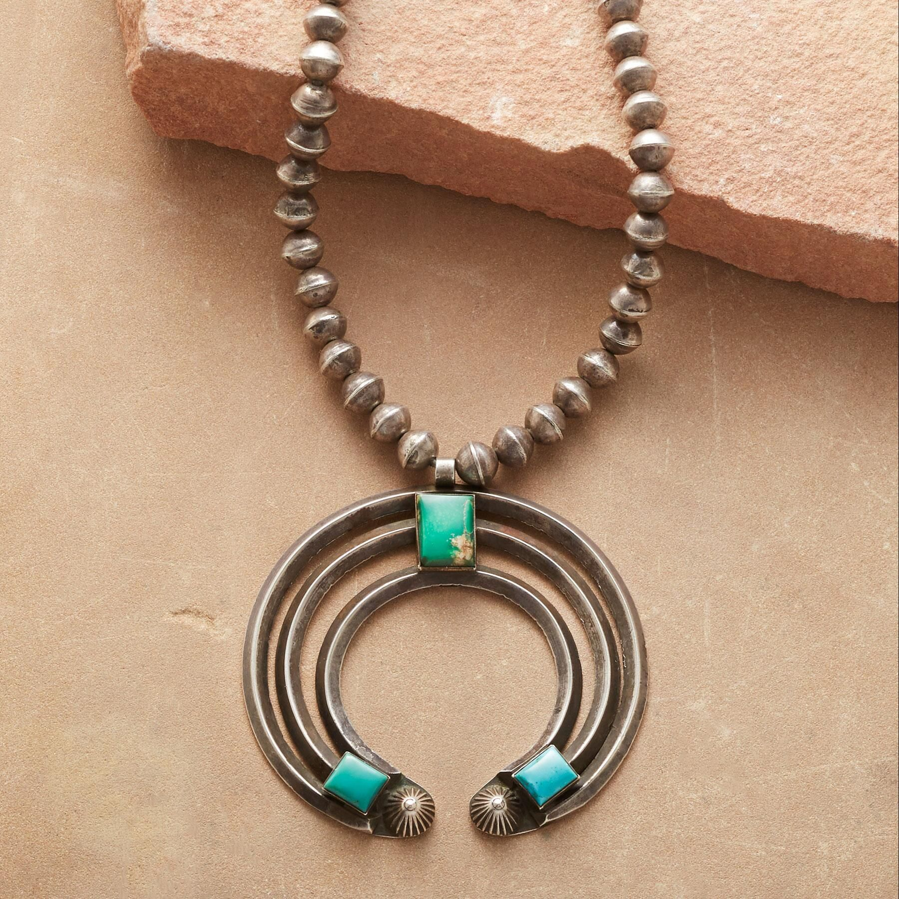 silver pendant product and sterling turquoise by american navajo native will denetdale artist indian royston