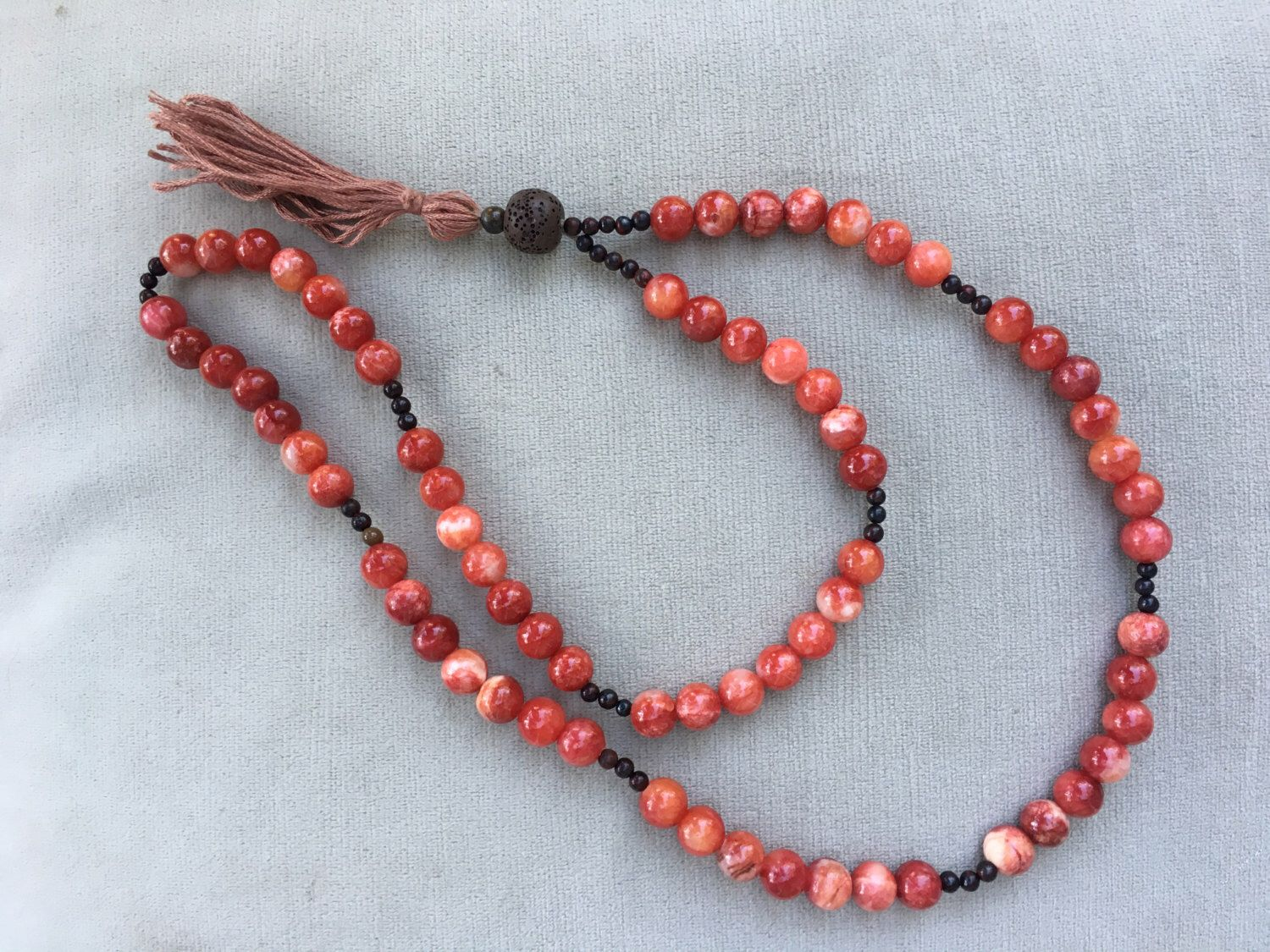A personal favorite from my Etsy shop https://www.etsy.com/listing/470016162/red-agate-brown-lava-and-red-brecciated