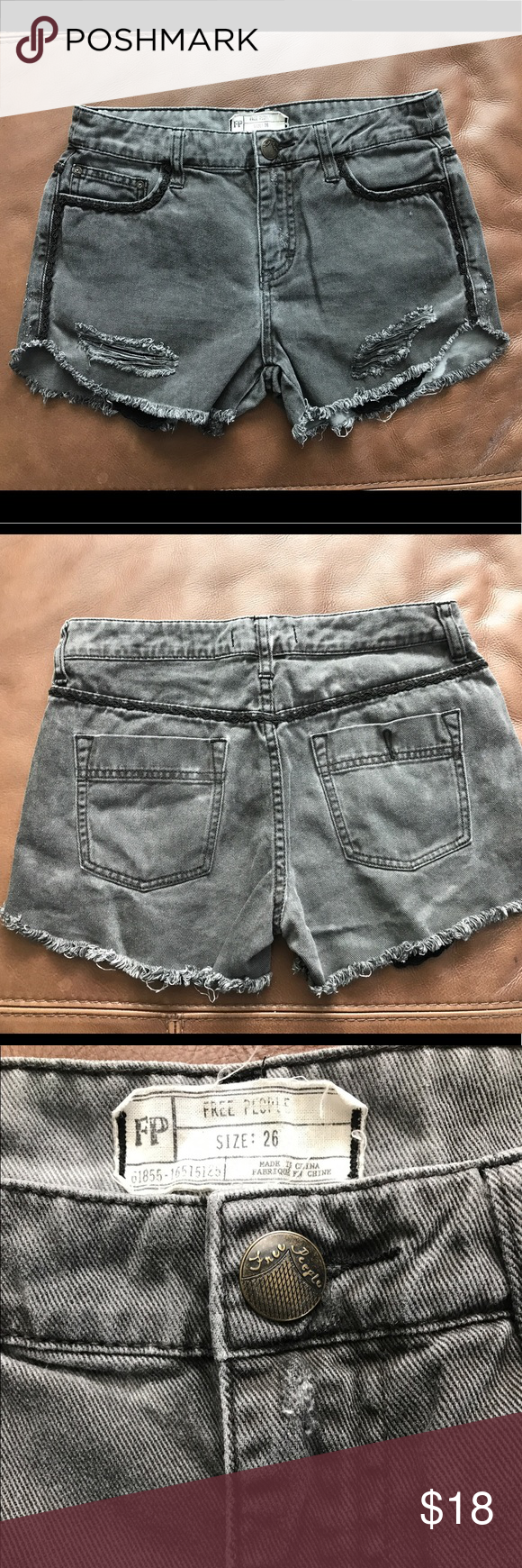 Free People Black Gray Denim Shorts size 26 Pre-loved distressed black, gray Free People shorts size 26 with embroidered detailing.   Please ask if you have any questions. 😀  Home is smoke free 🚭, but we have fur babies 🐰🐶. Free People Shorts Jean Shorts