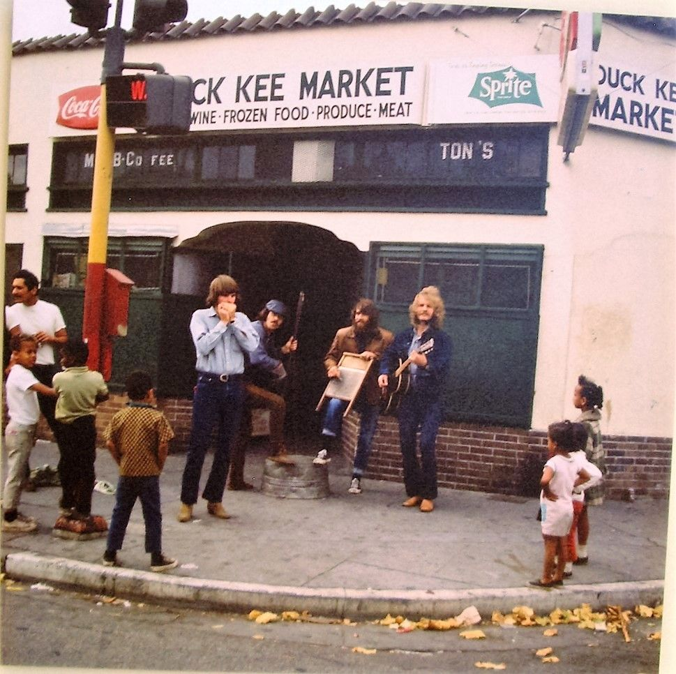 Creedence Clearwater Revival in front of the Duck Kee Market in ...