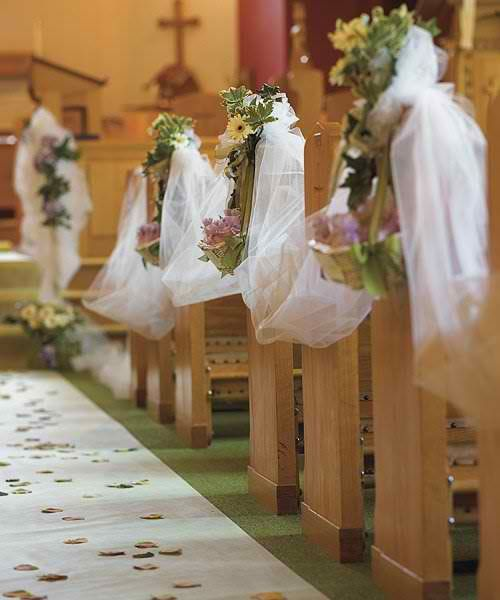 Wedding ceremony inside a church isle decor tulle fabric with wedding ceremony inside a church isle decor tulle fabric with floral arrangements on the pews junglespirit Image collections