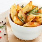Roasted potatoes with rosemary in a white bowl | The Oz Blog | Follow this Dr. Oz Recipe board Now and Make it later! #kartoffelrosenrezept