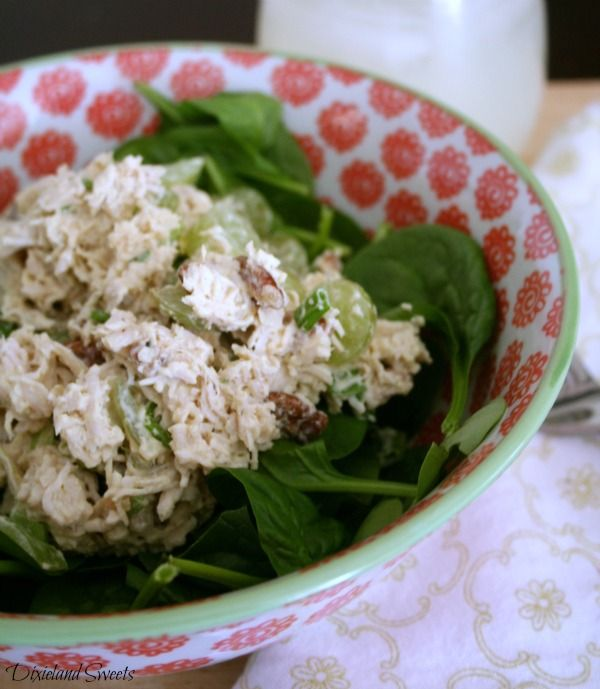 2 lbs turkey, cooked and shredded     ½ cup mayonnaise (Hellmann's or Homemade)     1 tablespoon yellow mustard     1 bunch green onions, chopped     1 cup sliced green grapes     ½ cup chopped pecans     1 teaspoon salt     1½ teaspoon pepper     Raw spinach for serving Can add dried cranberries or Almond slices instead of pecans