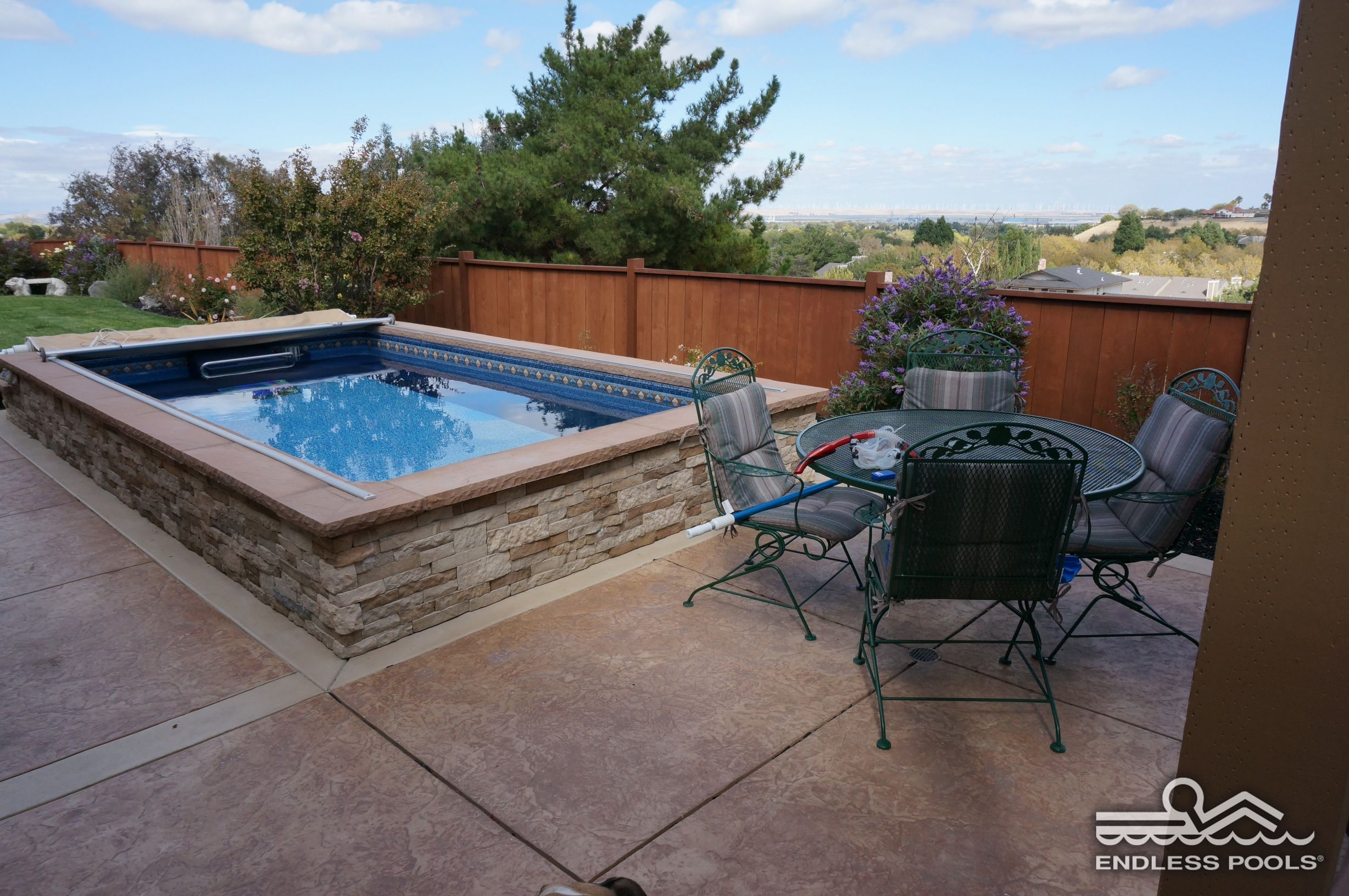 The Endless Pool Can Complete Your Patio Add A Spot For Exercise And Relaxation No Matter How Much Space You Have Endless Pool Small Pools Pool Houses