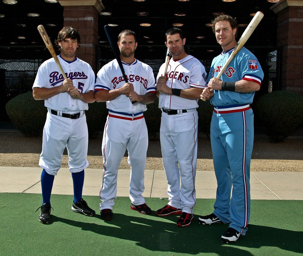 Ian Kinsler, Mike Napoli, Michael Young, and Josh Hamilton in throwback Texas  Rangers uniforms.