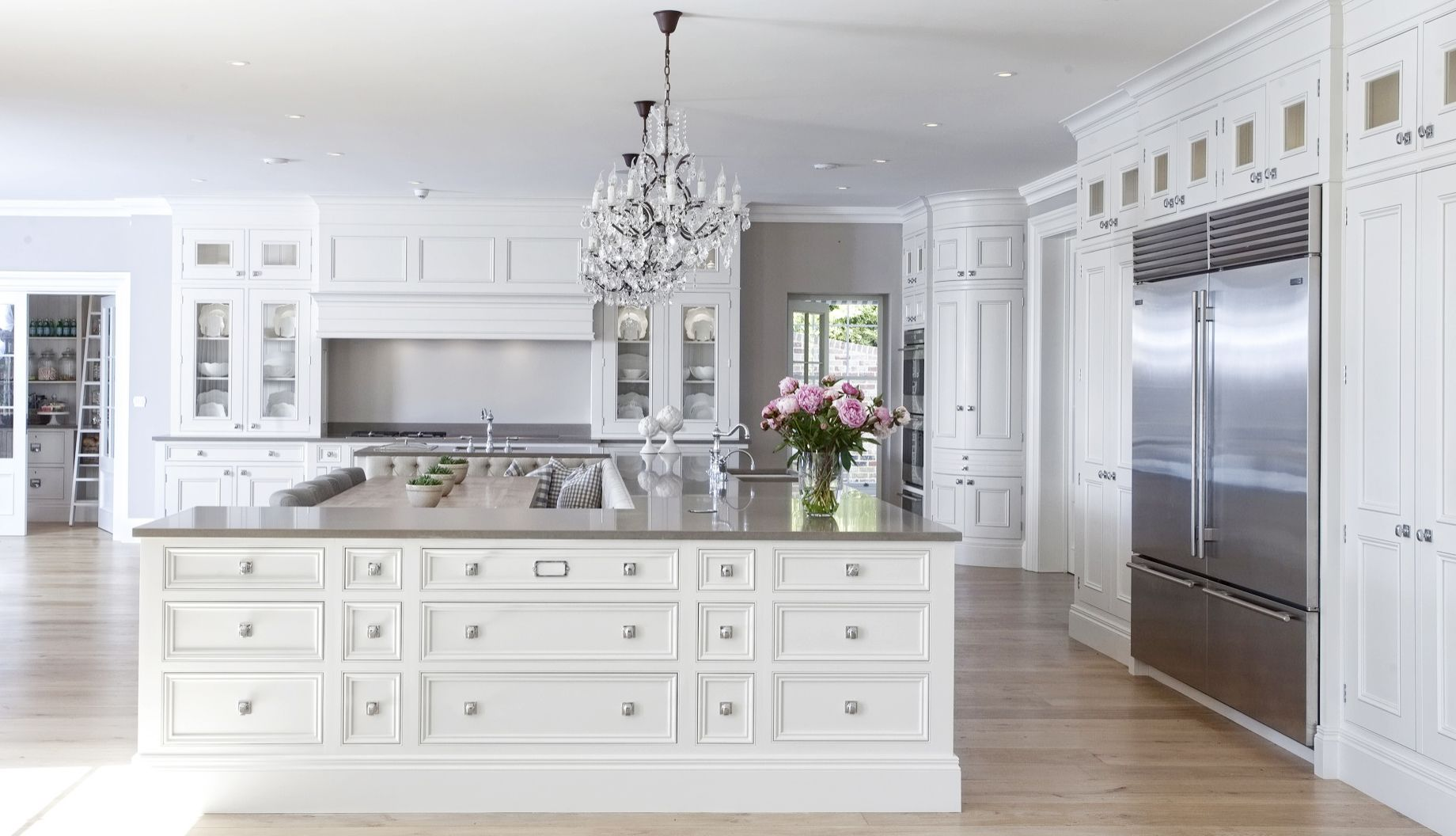 Neutral, Luxurious Kitchen With Three Chandeliers, Floor To Ceiling  Cabinetry