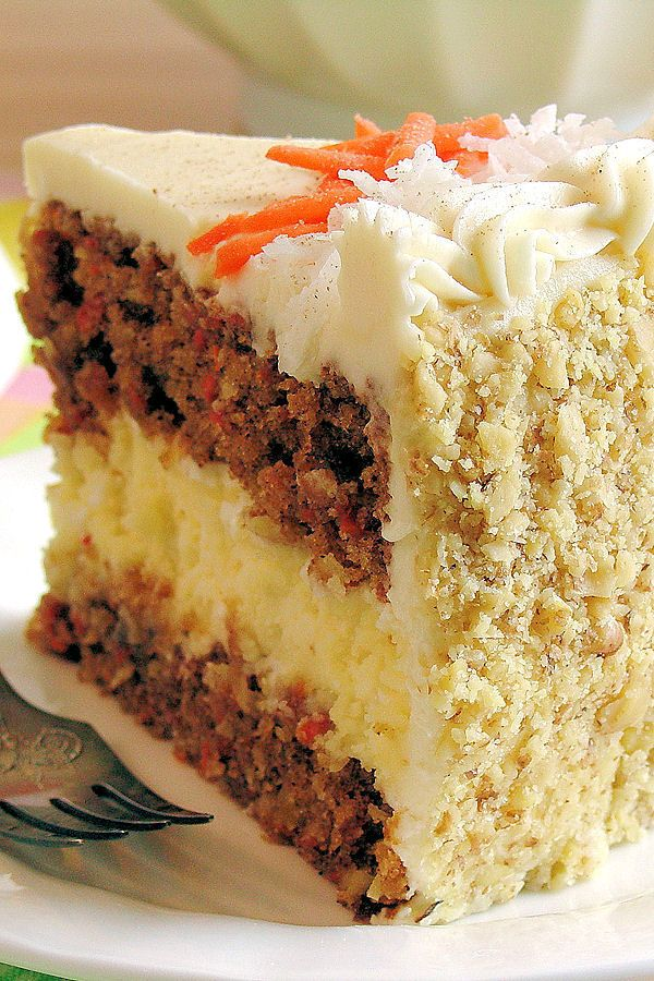 Carrot Cake Cheesecake Cake Bakery-Style ~ Moist carrot cake with a creamy cheesecake layer and the best cream cheese buttercream! Perfect dessert for Easter.