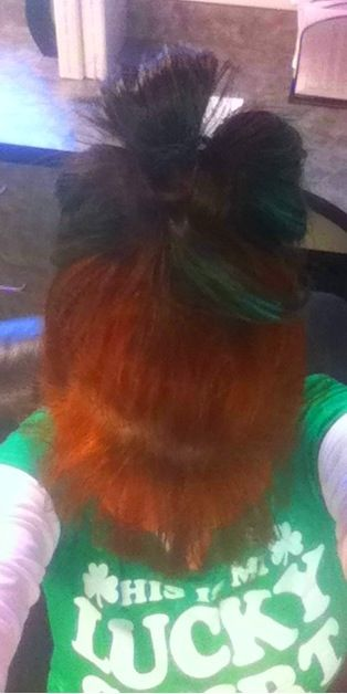 I turned my hair into a shamrock.. Super easy. 1) pull hair into a pony tail. On the last twist of the rubber band, leave hair in a reverse bubble on the top of your head, keeping 4in pointing toward your forehead. 2) split the 4in piece into 3 pieces. 3) take the left piece and the right piece, and pull them back to separate the hair bubble into three parts. 4)Tuck under and pin in the back. 5) Use water pastels to pain hair green. (washes out)