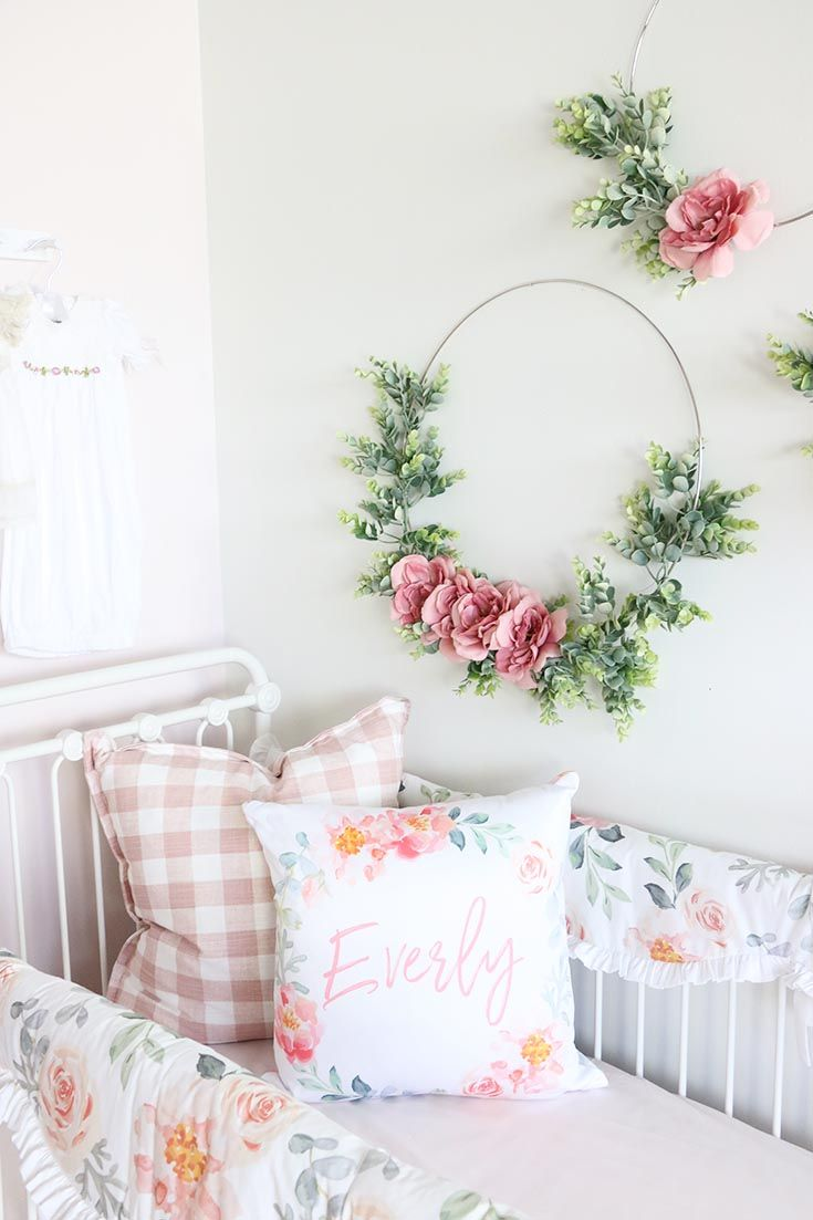 Love Love Love the look of these floral wreaths above the crib in a baby girl's nursery. #nursery #babynursery #babygirl #girlnursery #nurseryinspo