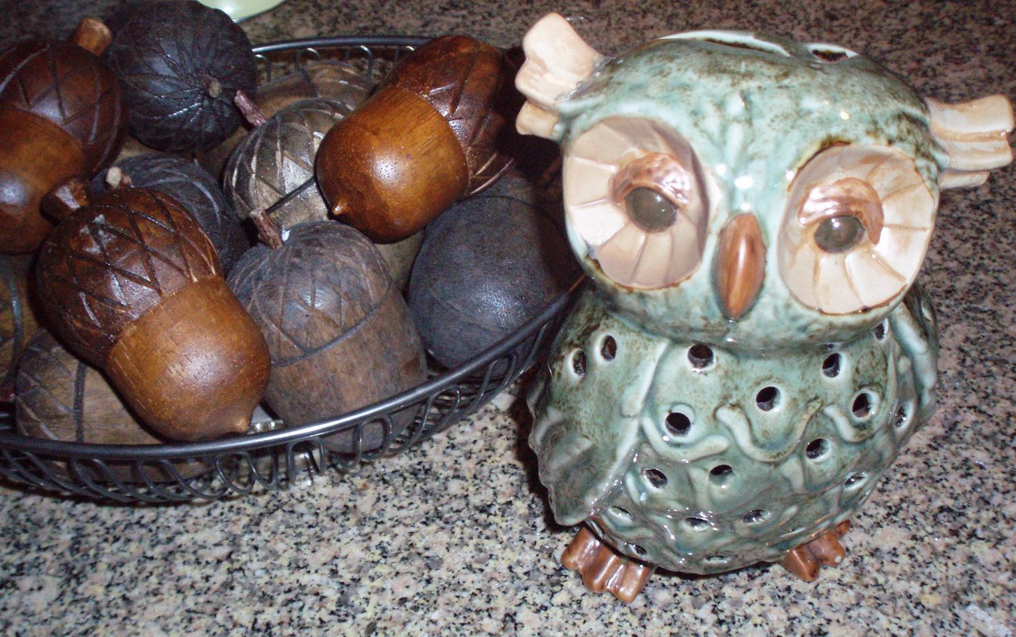 collection of wooden acorns and an owl