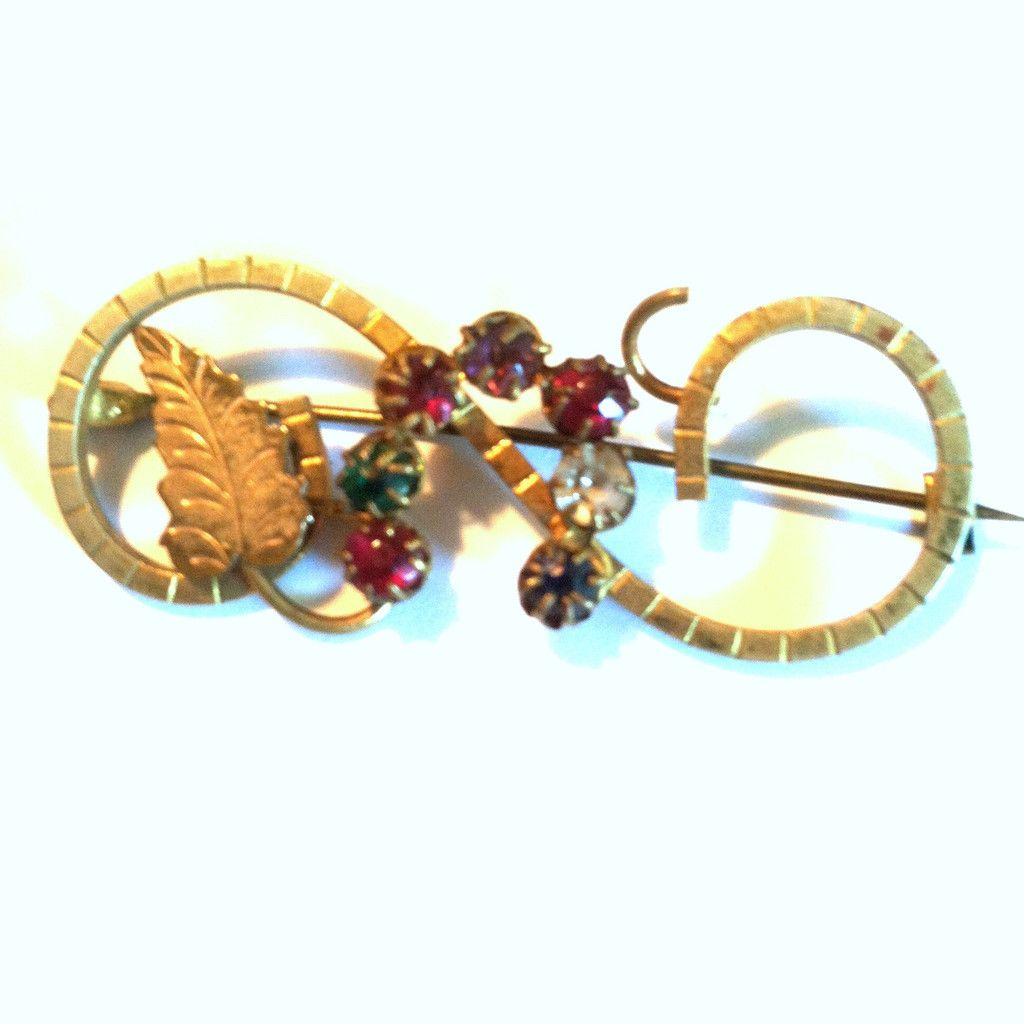 Rainbow Rhinestone and Etched Gold Sash Pin circa Early 1900s