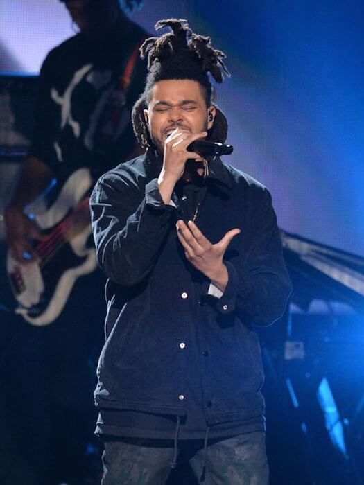 The Weeknd performing at the 2014 American Music Awards...